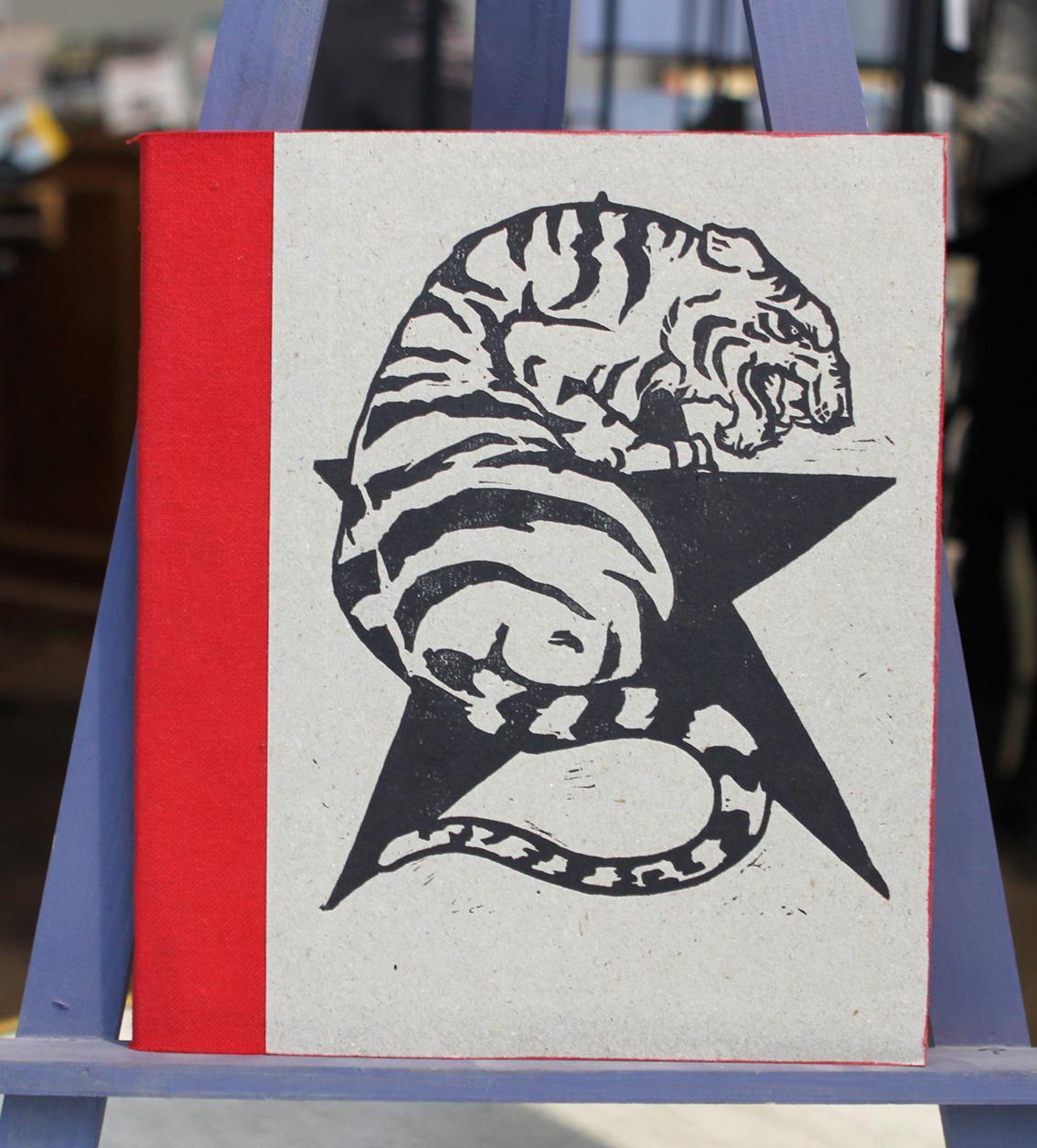 Artshop carnets Pierre Jourde tigre rouge etoile chevalet